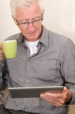 Senior working on a tablet pc Stock Images