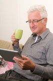 Senior working on a tablet pc Stock Image