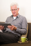 Senior working on a tablet pc Royalty Free Stock Images