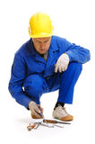 Senior workman selects the tools Royalty Free Stock Photography