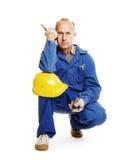 Senior workman squat. Isolated on white Stock Photo