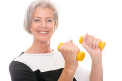 Senior at workout. Active senior woman at workout in front of white background Stock Photography