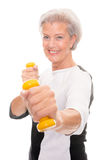 Senior at workout. Active senior woman at workout in front of white background Stock Photos