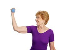 Senior Workout - Seventy & Str. A fit healthy seventy year old woman working out with freeweights.  Isolated on white Royalty Free Stock Photos