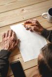 Senior writes a testament Stock Image