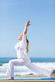 Senior yoga beach Royalty Free Stock Photos