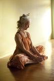 Senior Yoga Meditation Woman. Beautiful mature woman in the sitting yoga posture baddhakonasana or bound angle pose Stock Image