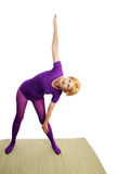 Senior Yoga - Triangle Pose royalty free stock photography