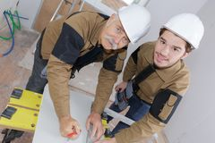 Senior and young builder stock photography