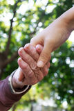 Senior and Young hands Stock Image
