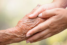 Senior and young holding hands Stock Photography