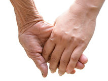 Senior and young holding hands Royalty Free Stock Image