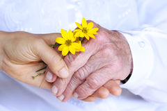 Senior & Young Ladies Holding Hands Royalty Free Stock Photos
