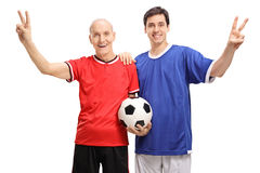 Senior and a young man making victory signs Royalty Free Stock Images
