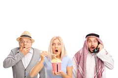 Senior, young woman and an arab man making surprise gestures Royalty Free Stock Photo