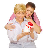 Senior and young woman with gift Stock Image