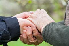 Senior & young woman holding hands Stock Photography