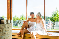 Senior and young woman in sauna sweating Royalty Free Stock Photography