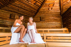 Senior and young woman in sauna sweating Stock Photos