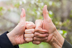 Senior & young woman showing thumbs up Stock Photos