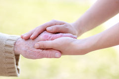 Senior and Young Women Holding Hands. Senior lady and young women holding hands Stock Images