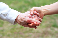 Senior and Young Women Holding Hands Royalty Free Stock Photography