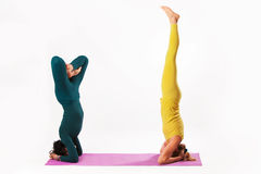 Senior and younger woman practice yoga Stock Photo