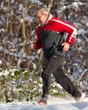 seniora działający śnieg Fotografia Royalty Free