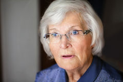 Seniorin  looking shocked Royalty Free Stock Photography