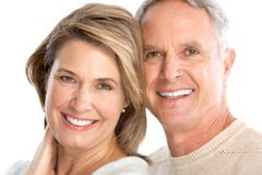 Seniors. Happy seniors couple in love. Isolated over white background stock images