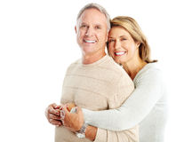 Seniors. Happy seniors couple in love. Isolated over white background Stock Photos