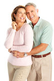 Seniors. Happy seniors couple in love. Isolated over white background Stock Photography