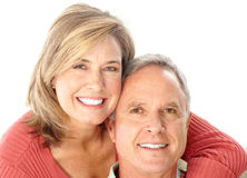 Seniors. Happy seniors couple in love. Isolated over white background Royalty Free Stock Images