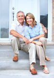 Seniors. Smiling happy elderly seniors couple near the home Royalty Free Stock Photography