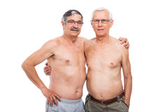 Seniors. Portrait of two shirtless elderly men, isolated on white background Royalty Free Stock Photography