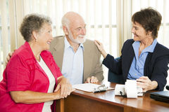 Seniors with Accountant. Senior couple gets good news from their accounant Royalty Free Stock Photography