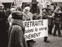 Seniors with banner At retirement we want to live with dignity. STRASBOURG, FRANCE - MAR 22, 2018: At retirement we want to live with dignity - seniors with royalty free stock photos