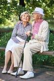 Seniors on bench Stock Image