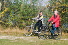 Seniors on a bike Royalty Free Stock Photography