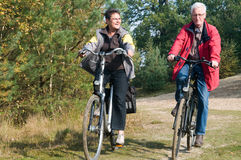 Seniors on a bike Royalty Free Stock Image