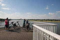 Seniors on a bike - view of the Rhinew. Seniors cycling in the Rhine in Duesseldorf Stock Photo