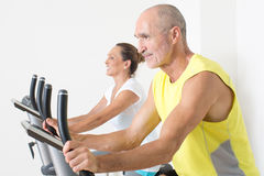 Seniors on bikes in gym Stock Images