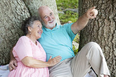 Seniors Bird-Watching in the Park Royalty Free Stock Photos