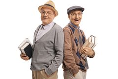 Seniors with books looking at the camera and smiling Stock Photo