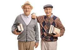 Seniors with books looking at the camera and smiling Royalty Free Stock Image