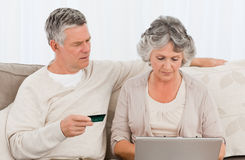 Seniors buying something on internet Royalty Free Stock Photo