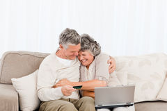Seniors buying something on internet Royalty Free Stock Images