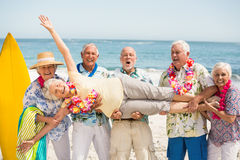Seniors carrying senior woman Royalty Free Stock Photography