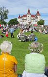 Seniors celebrating midsummer. Old women with flower in their hair celebrating midsummer at Lacko castle close to lake Vanern, Sweden Royalty Free Stock Image