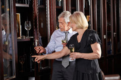Seniors with champagne at wine Stock Photos